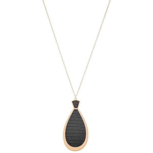 "Long Necklace Featuring Metal Encased Faux Leather Teardrop Pendant.  - Pendant 3"" L  - Approximately 36"" L  - Adjustable 3"" Extender"