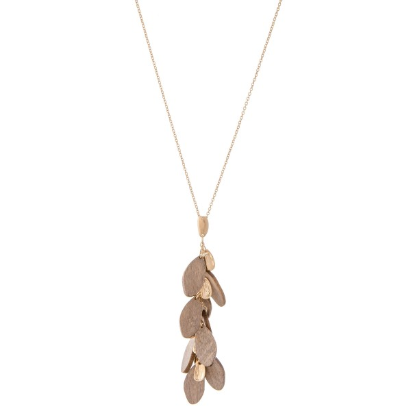 """Long Necklace Featuring Wooden Leaf Tiered Pendant.  - Pendant 3"""" L  - Approximately 34"""" L  - Adjustable 3"""" Extender"""