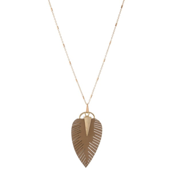 """Long Necklace Featuring Faux Leather Leaf Pendant with Gold Accent.  - Pendant 3.5"""" L - Approximately 36"""" L  - Adjustable 3"""" Extender"""