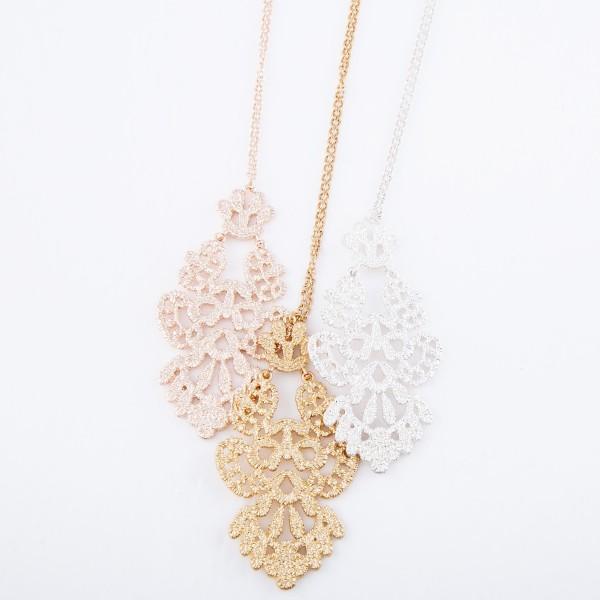 "Long Necklace Featuring Metal Filigree Pendant.  - Pendant 3.25"" L  - Approximately 36"" L  - Adjustable 3"" Extender"
