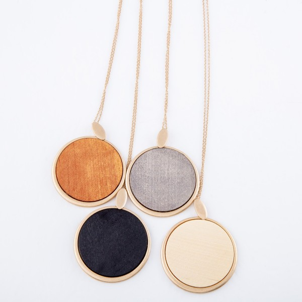 """Long Necklace Featuring Metal Encased Wooden Circle Pendant.  - Pendant approximately 2"""" in diameter - Approximately 34"""" L  - Adjustable 3"""" Extender"""