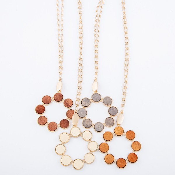 "Long Necklace Featuring Metal Encased Wooden Circular Pendant.  - Pendant approximately 2"" in diameter - Approximately 34"" L  - Adjustable 3"" Extender"