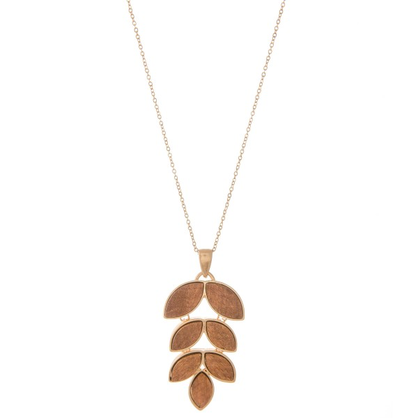 "Long Necklace Featuring Metal Encased Wooded Leaf Pendant.  - Pendant 2.5"" L  - Approximately 34"" L  - Adjustable 3"" Extender"