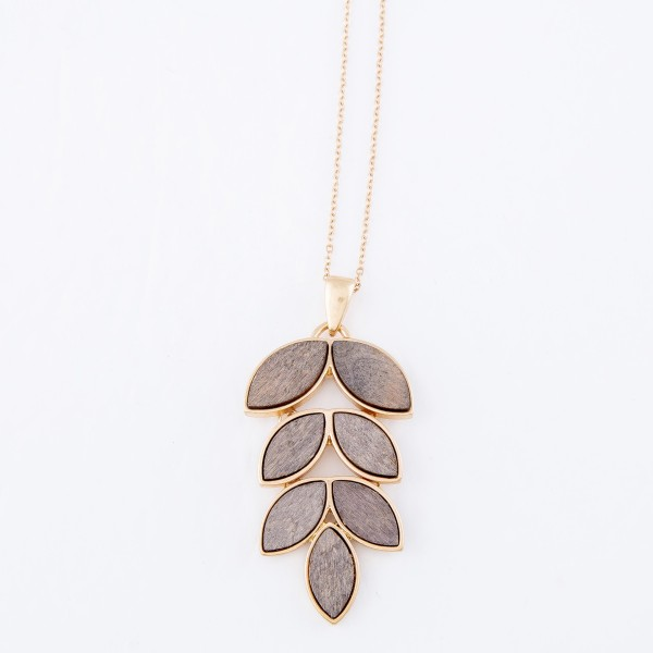 "Long Necklace Featuring Metal Encased Wooded Leaf Pendant.  - Pendant 2.5"" L  - Approximately 34"" L  - Adjustable 3"" Extender"