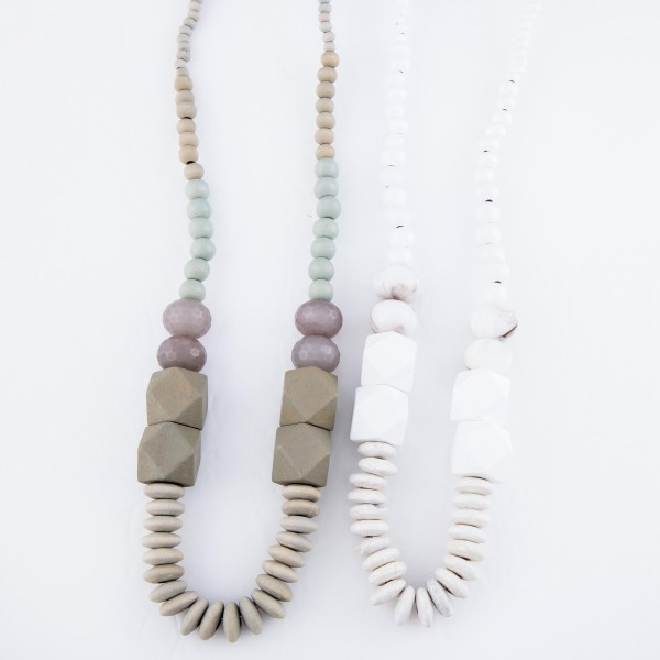 "Long Wood Beaded Statement Necklace Featuring Glass Bead Details.  - Approximately 28"" L  - Pull through Button Closure"