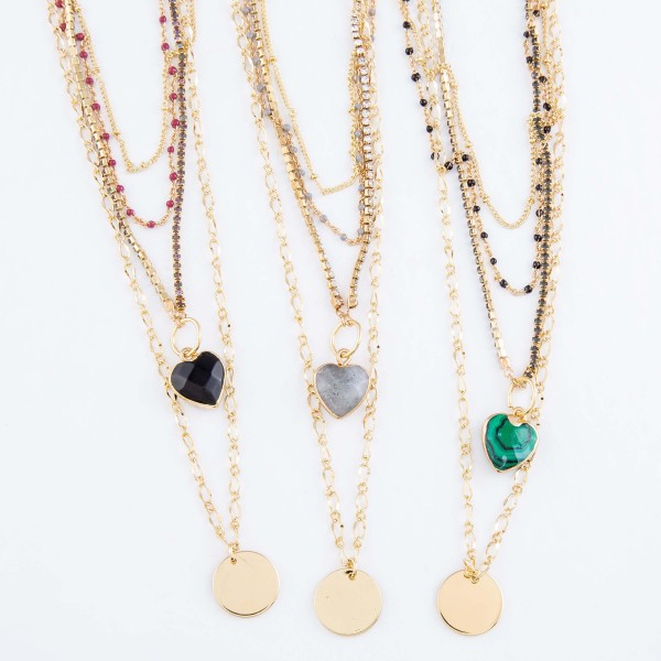"Layered Natural Stone Heart Coin Pendant Necklace Featuring Rhinestone and Enamel Details.  - Pendant's (approx) .5""  - Approximately 20"" L  - 3"" Adjustable Extender"