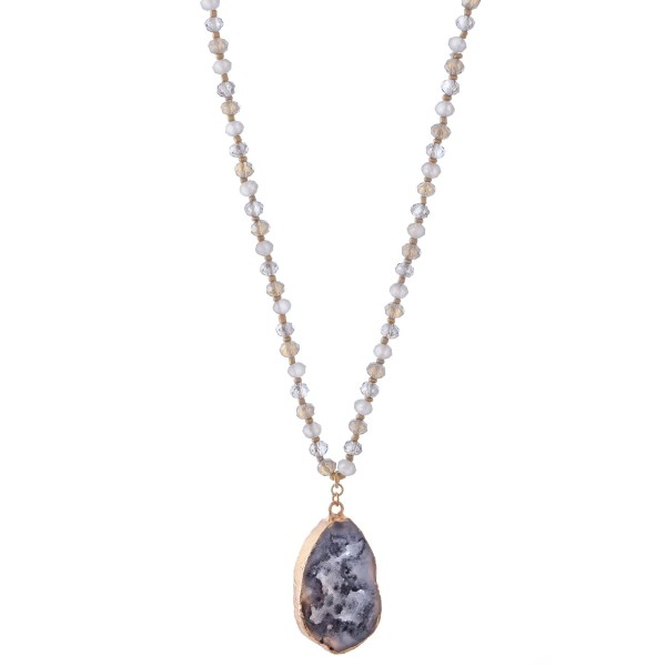 "Long Faceted Beaded Necklace Featuring Druzy Teardrop Pendant.  - Pendant 1.75""  - Color: Grey - Approximately 34"" L  - 3"" Adjustable Extender"