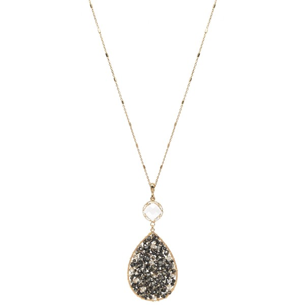 "Long Necklace Featuring Beaded Rhinestone Filled Teardrop Pendant with Crystal Accent.  - Pendant 3.5""  - Approximately 36' Long  - 3"" Adjustable Extender"