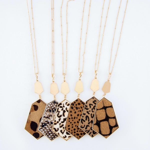 """Long Necklace Featuring Metal Encased Leopard Print Pendant in Gold.  - Pendant 4"""" Long - Animal Print - Approximately 36"""" Long  - 3"""" Adjustable Extender"""
