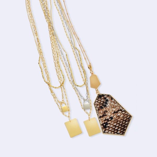 """Long Necklace Featuring Metal Encased Snakeskin Print Pendant in Gold.  - Pendant 4"""" Long - Animal Print - Approximately 36"""" Long  - 3"""" Adjustable Extender"""