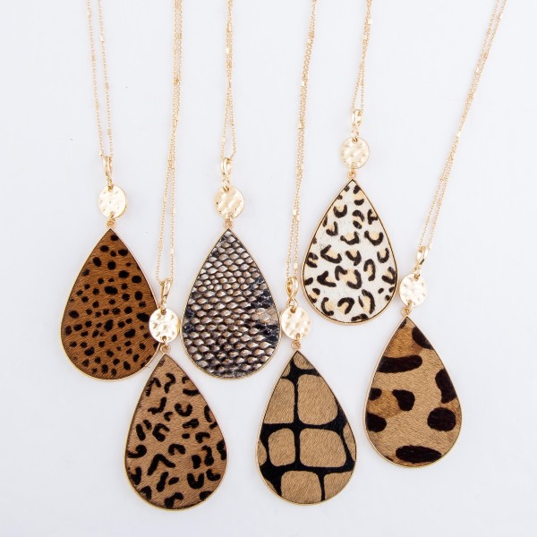 "Metal Encased Giraffe Print Teardrop Pendant Necklace in Gold.  - Pendant 3"" - Approximately 36"" L - 3"" Adjustable Extender"