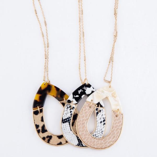 "Long Necklace Featuring Tortoise Leopard Print Teardrop Pendant.  - Pendant 2""  - Approximately 38"" L  - 3"" Adjustable Extender"