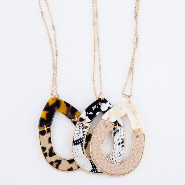 "Long Necklace Featuring Resin Animal Print Teardrop Pendant.  - Pendant 2""  - Approximately 38"" L  - 3"" Adjustable Extender"