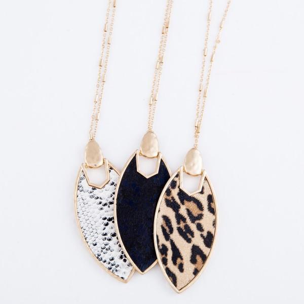 "Long Necklace Featuring Metal Encased Leopard Print Pendant.  - Pendant 3""  - Approximately 38"" L  - 3"" Adjustable Extender"