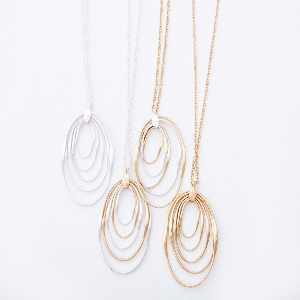 "Two Tone Oval Layered Pendant Necklace.  - Pendant 2.5""  - Approximately 34"" L  - 3"" Adjustable Extender"