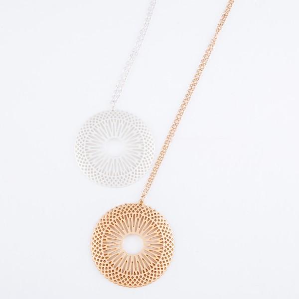 "Sunburst Cut Pendant Necklace in a Matte Finish.  - Pendant 2""  - Approximately 34"" L  - 3"" Adjustable Extender"
