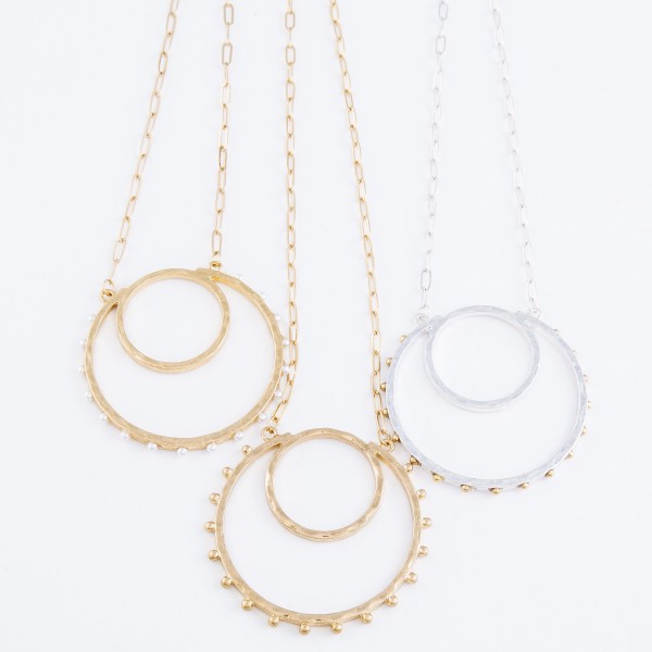"Long Two Tone Circular Pendant Necklace Featuring Stud Accents.  - Pendant 2.5""  - Approximately 32"" L - 3"" Adjustable Extender"