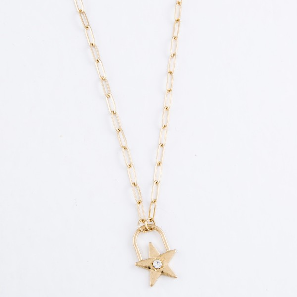 "Paperclip Chain Necklace in Worn Gold Featuring Star Lock Pendant with Rhinestone Accent.  - Pendant .75"" - Approximately 16"" L  - 3"" Adjustable Extender"