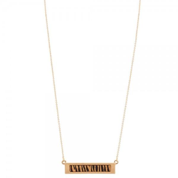 """Metal Encased Wooden Zebra Print Bar Necklace.  - Bar Pendant 1.5""""  - Approximately 16"""" Long - 3"""" Adjustable Extender"""