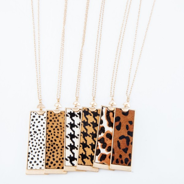 "Long Necklace Featuring Metal Encased Genuine Leopard Print Rectangle Pendant.  - Pendant 3""  - Approximately 36"" Long  - 3"" Adjustable Extender"