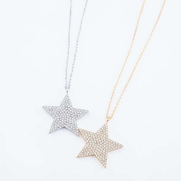 "Long Necklace Featuring Rhinestone Filled Star Pendant in Gold.  - Pendant 2""  - Approximately 36"" Long  - 3.5"" Adjustable Extender"