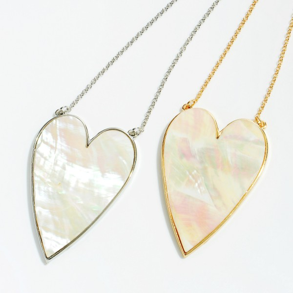 "Mother of Pearl Heart Pendant Necklace in Rhodium.  - Pendant 2""  - Approximately 18"" in Length - 3"" Adjustable Extender"