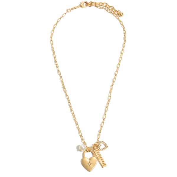 "Mama Heart Padlock Pendant Necklace Featuring a Pearl Accent in a Worn Gold.  - Pendant 1""  - Approximately 18"" in Length - 3"" Adjustable Extender"