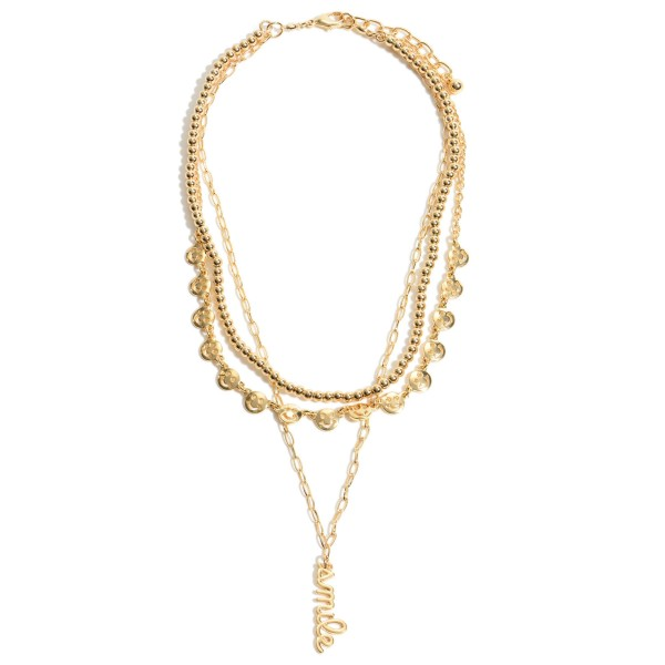 """Smiley Face Chain Link Layered Necklace in Gold Featuring Smile Pendant.  - Pendant 1.25""""  - Shortest Layer 12""""  - Approximately 20"""" in Length - 3"""" Adjustable Extender"""