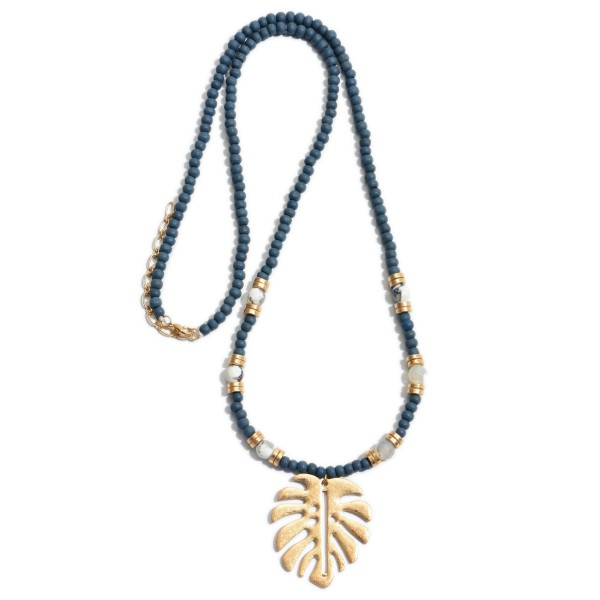 """Long Wood Beaded Palm Leaf Necklace Featuring Semi Precious Details.  - Pendant 2""""  - Approximately 30"""" in Length - 2"""" Adjustable Extender"""