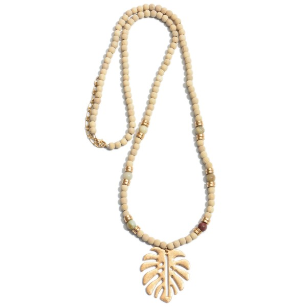 "Long Wood Beaded Palm Leaf Necklace Featuring Semi Precious Details.  - Pendant 2""  - Approximately 30"" in Length - 2"" Adjustable Extender"