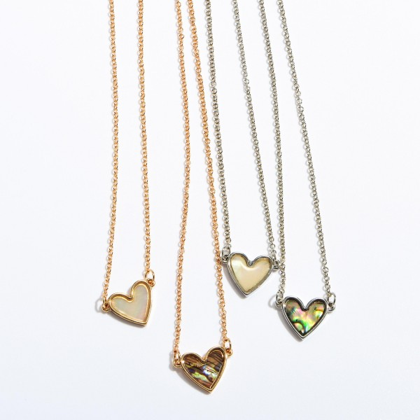 """Mother of Pearl Heart Necklace in Rhodium.  - Pendant .5""""  - Approximately 16"""" in Length - 3"""" Adjustable Extender"""