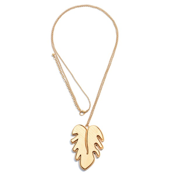 "Long Necklace Featuring a Wood Palm Leaf Pendant in Gold.  - Pendant 2.5"" - Approximately 36"" in Length - 3"" Adjustable Extender"