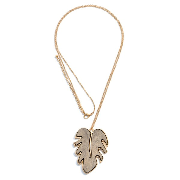 """Long Necklace Featuring a Wood Palm Leaf Pendant in Gold.  - Pendant 2.5"""" - Approximately 36"""" in Length - 3"""" Adjustable Extender"""