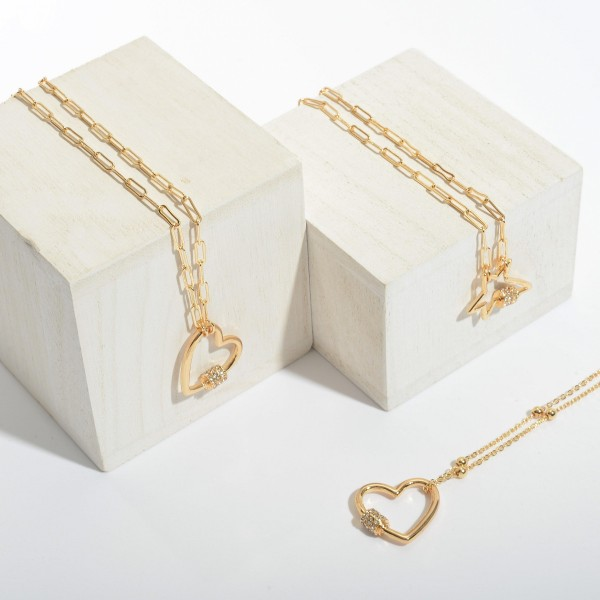 """Ball Chain Heart Carabiner Necklace in Gold Featuring Rhinestone Accents.  - Pendant 1""""  - Approximately 16"""" in Length - 3"""" Adjustable Extender"""