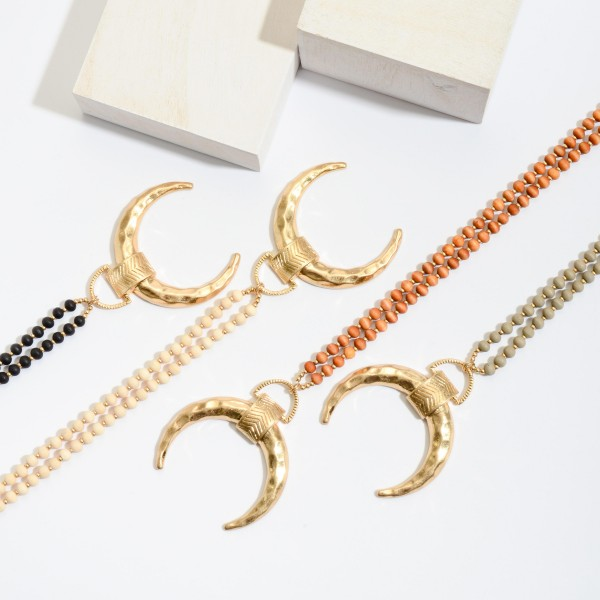 """Long Wood Beaded Necklace Featuring Gold Crescent Pendant.  - Pendant 2"""" in Diameter  - Approximately 36"""" in Length - 3"""" Adjustable Extender"""