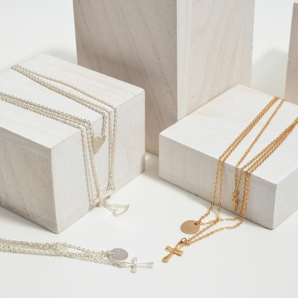 """3-Piece Layered Heart Cross Necklace Set.  - 3 Necklaces Per Set - Pendant .5""""  - Approximately 18"""" in Length  - 3"""" Adjustable Extender"""