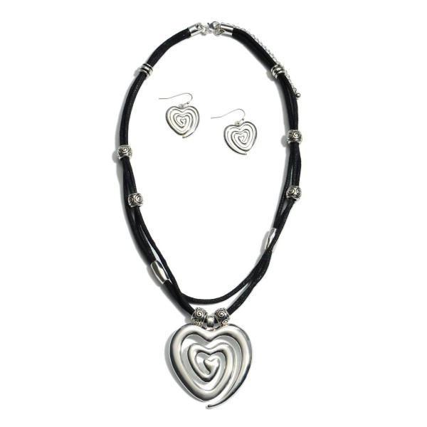 "Tribal Heart Layered Cord Necklace with Beaded Details.  - Pendant 2""  - Approximately 18"" in Length - 3"" Adjustable Extender"