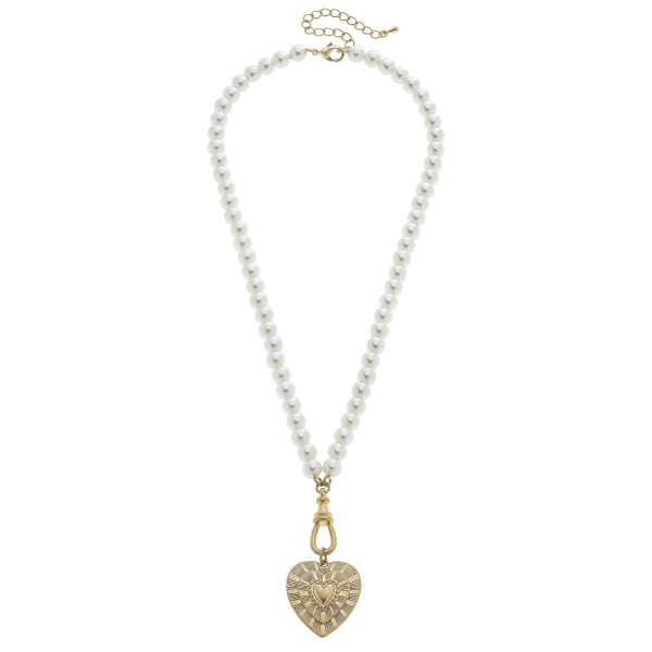 "Ivory Pearl Beaded Heart Pendant Necklace in Worn Gold.  - Pendant 1.5""  - Approximately 24"" in Length - 3"" Adjustable Extender"