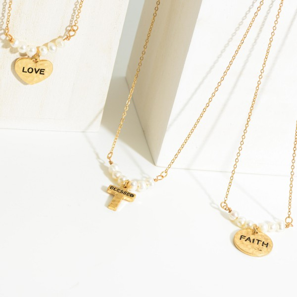 "Short Gold Chain Necklace Featuring Faux Pearl Accents and Hammered Textured Pendant That Says ""Love"".   - Approximately 18"" Long"