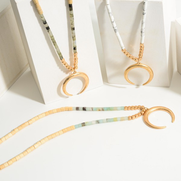 """Long Necklace Featuring Wood Beads, Natural Stone Accents, and Gold Crescent Pendant.   - Approximately 36"""" Long"""