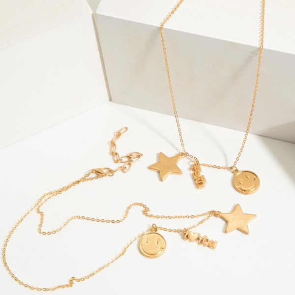 """Short Gold Chain Necklace Featuring Star and Smiley Face Accents and Pendant That Says """"Faith"""".   - Approximately 18"""" Long"""