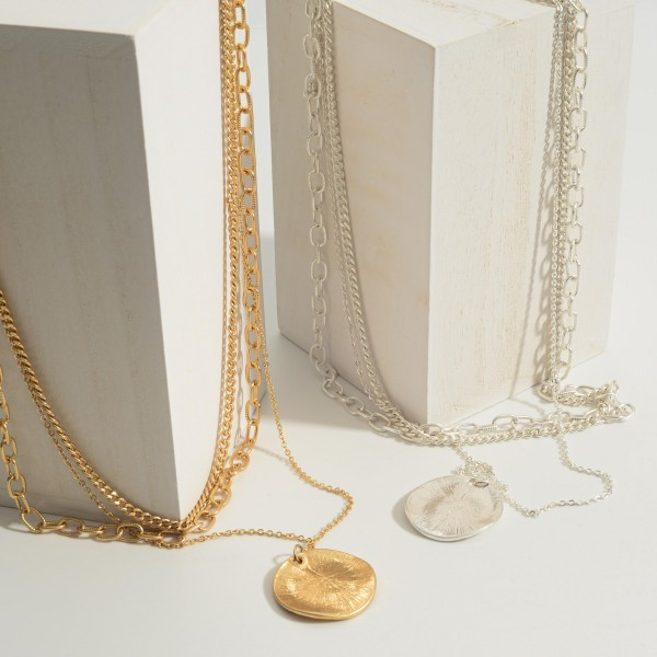 "Layered Metal Chain Necklace Featuring a Textured Pendant.   - Approximately 20"" in Length  - Adjustable 3"" Extender"