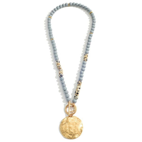 """Beaded Necklace Featuring Natural Stone Accents and Hammered Gold Pendant.   - Approximately 24"""" in Length  - Adjustable 3"""" Extender"""