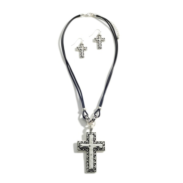 """Leather Necklace Featuring Hammered Silver Cross Pendant and Engraved Details.   - Approximately 18"""" Long - Adjustable 3"""" Extender  - Each Necklace Comes with Silver Cross Earrings that Match Necklace Pendant"""