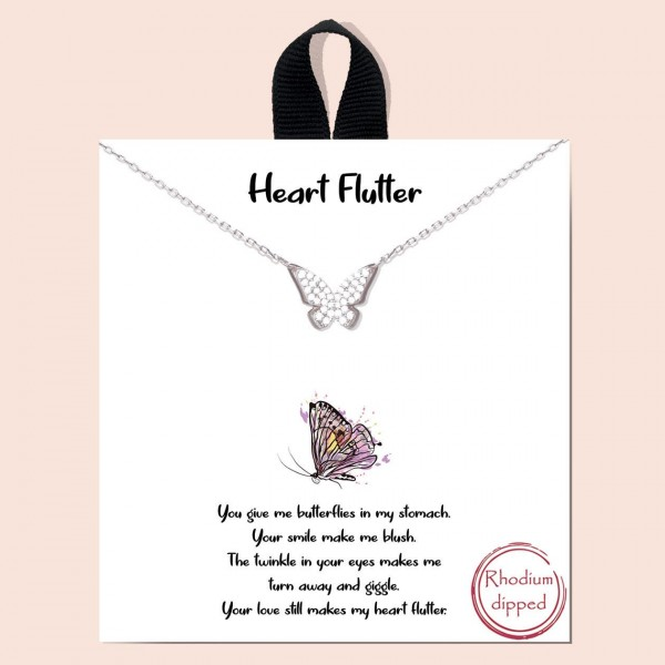 "Short Metal Necklace Featuring a CZ Adorned Butterfly Pendant.   - Approximately 18"" Long  - Each Necklace Comes on a Card that Says ""You give me butterflies in my stomach. Your smile makes me blush. The twinkle in your eyes makes me turn away and giggle. Your love still makes my heart flutter"".  - Great for Gifts!"