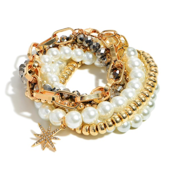 "Set of Six Bracelets Featuring Faux Pearls, Hematite Beads, and Gold Chain Bracelet.   - Approximately 2.5"" in Diameter"
