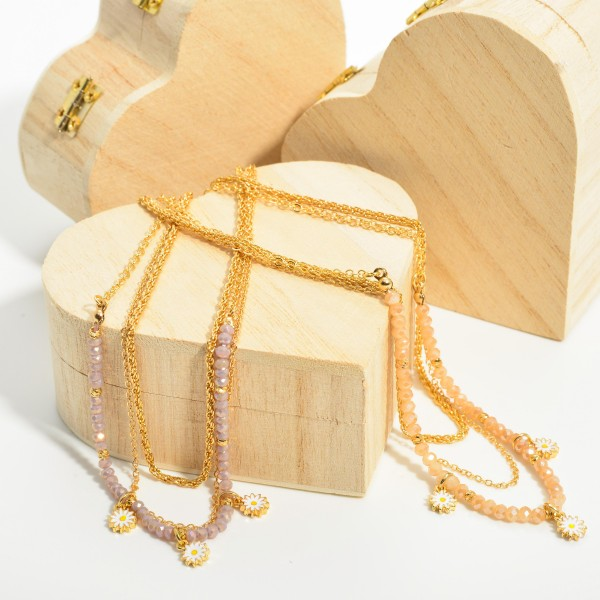 """Triple Stranded Necklace Featuring Beaded Accents and Three Floral Pendants.   - Approximately 18"""" Long"""