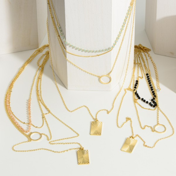 """Gold Layer Necklace featuring Beaded Accents and a Gold Pendant.   - Approximately 12.5"""" in Length - Extender 3"""" in Length"""