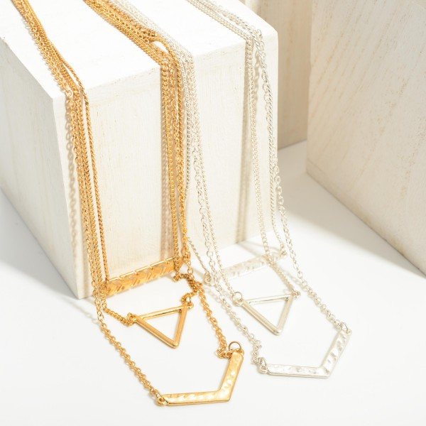 """Set of Three Metal Necklaces Featuring Metal Pendants.   - Necklaces Approximately 16"""", 18"""", and 20"""" Long"""