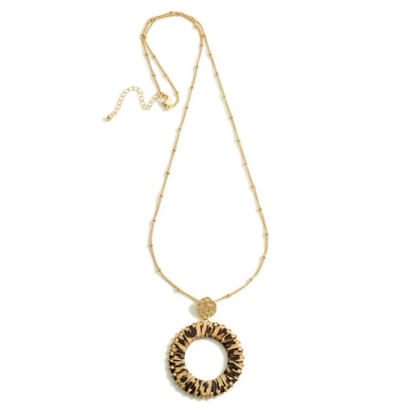 """Long Gold Necklace Featuring a Circular Pendant with Animal Print Accents.  - Approximately 18"""" in Length - Extender Approximately 3"""" in Length"""